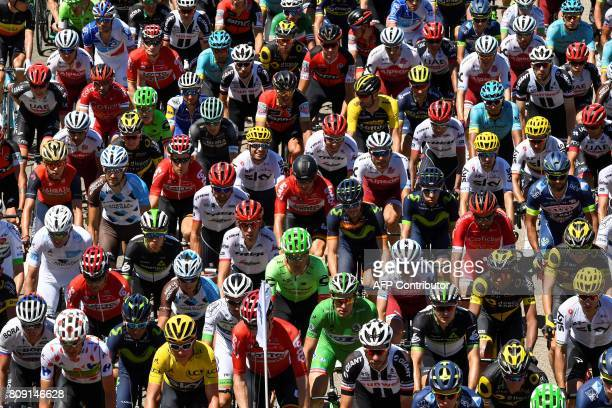 Riders including USA's Nathan Brown wearing the best climber's polka dot jersey Colombia's Nairo Quintana Great Britain's Geraint Thomas wearing the...