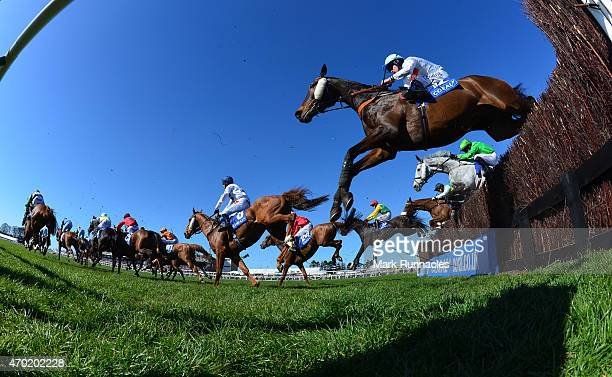 Riders jump the first fence during the Coral Scottish Grand National Handicap Chase on the second day of the Scottish Grand National Festival at Ayr...