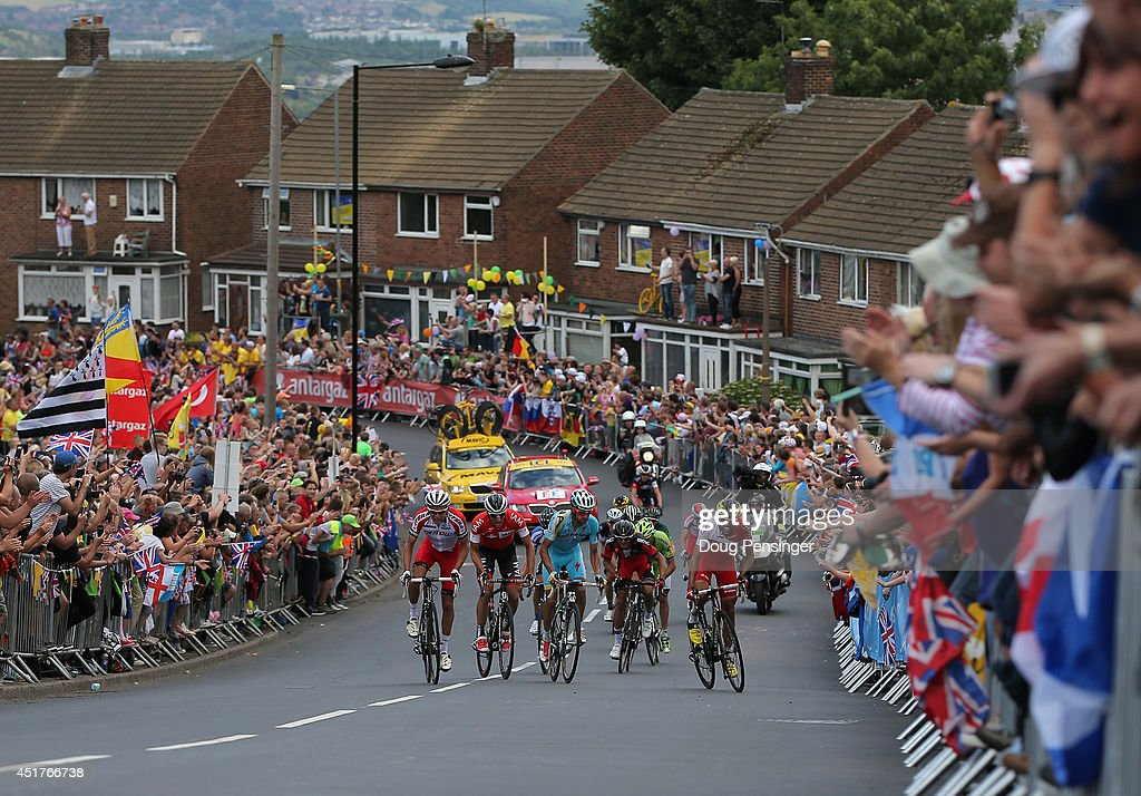 Riders make the climb of the Cote de Kenkins Road to the excitement of the fans during stage two of the 2014 Le Tour de France from York to Sheffield...