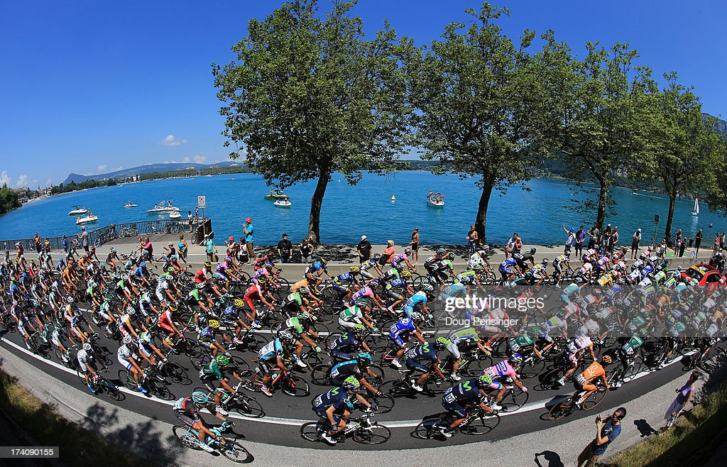 Riders make their way around Lake Annecy at the start of stage twenty of the 2013 Tour de France, a 125KM road stage from Annecy to Annecy-Semnoz, on July 20, 2013 in Annecy, France.