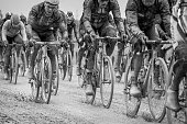 Riders make their way over a dirt road after steady rain during stage 5 of the Tour of Alberta on September 6 2015 in Edson Alberta Canada