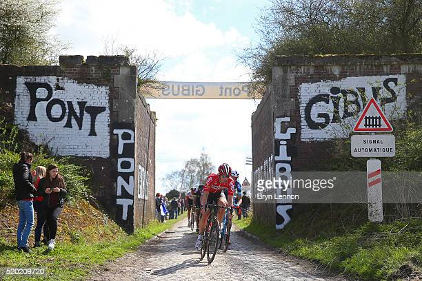 Riders make their way past Pont Gibus during the 2016 Paris Roubaix cycle race from Compiegne to Roubaix on April 10 2016 at an unspecified location...