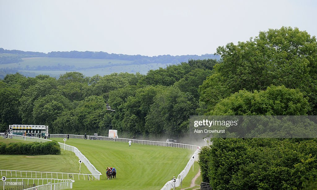 Riders make their way up the track in The Westover Jaguar F-Type Maiden Stakes at Salisbury racecourse on June 26, 2013 in Salisbury, England.