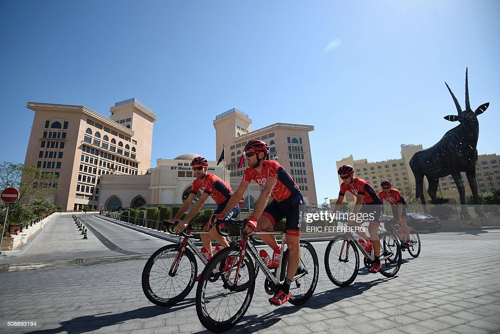 Riders of Australia's Drapac cycling team practice on the eve of the fifteenth edition of the Tour of Qatar in Doha, on February 7, 2016. / AFP / Eric FEFERBERG