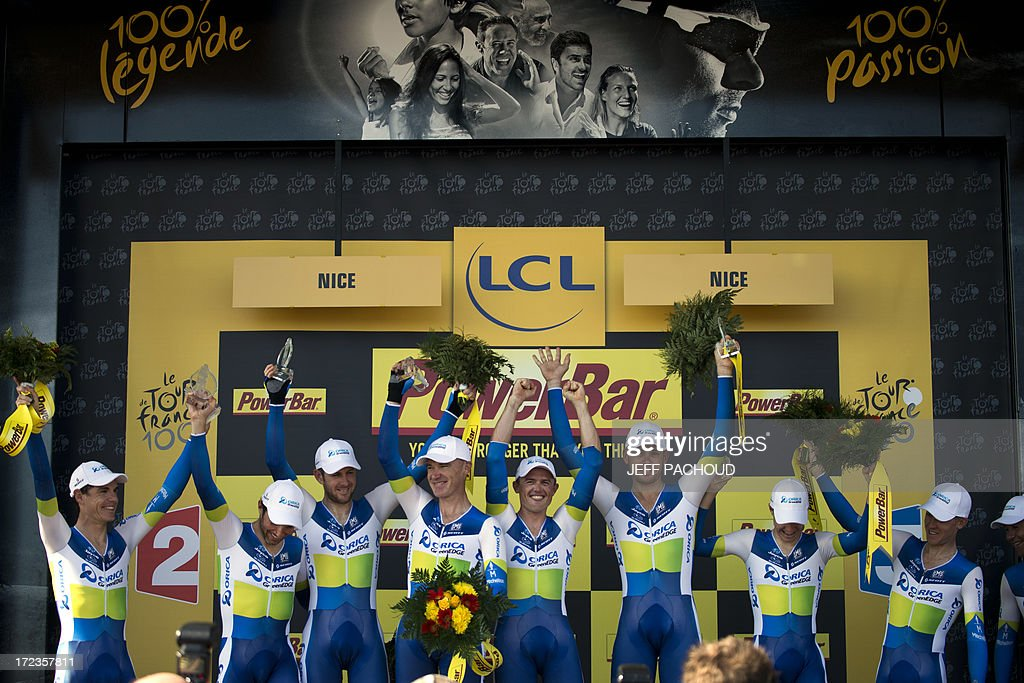 Riders of Orica Greenedge team celebrate on the podium after winning the 25 km team time-trial and fourth stage of the 100th edition of the Tour de France cycling race on July 2, 2013 around Nice, southeastern France.