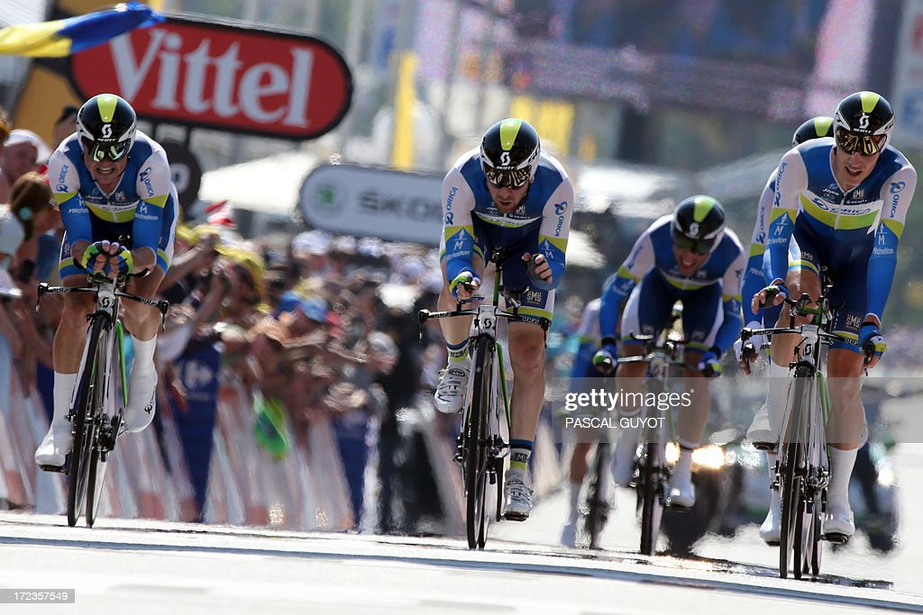 Riders of Orica Greenedge team cross the finish line at the end of the 25 km team time-trial and fourth stage of the 100th edition of the Tour de France cycling race on July 2, 2013 around Nice, southeastern France. AFP PHOTO / PASCAL GUYOT