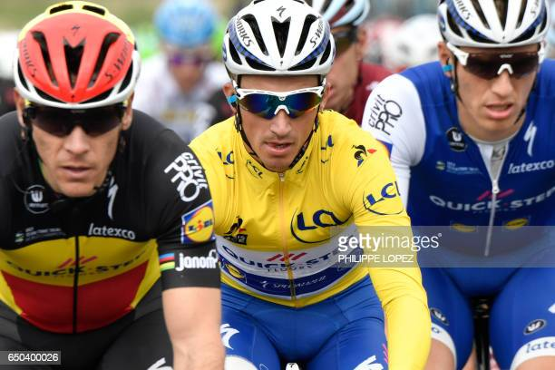 Riders of the Belgium's Quick Step Floors cycling team Belgium's Philippe Gilbert France's Julian Alaphilippe wearing the overall leader's yellow...
