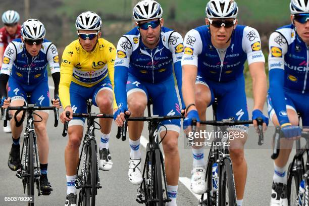 Riders of the Belgium's Quick Step Floors cycling team Ireland's Daniel Martin France's Julian Alaphilippe wearing the overall leader's yellow jersey...