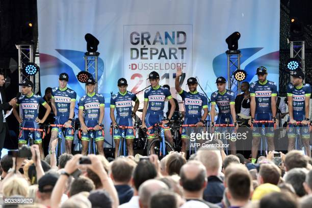 Riders of the Belgium's Wanty Groupe Gobert cycling team stand on stage during the team presentation ceremony in Dusseldorf Germany on June 29 two...