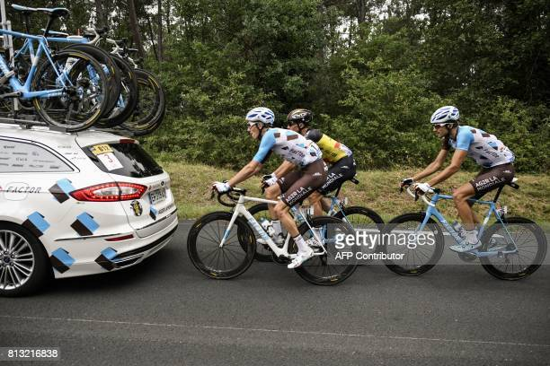 Riders of the France's AG2R La Mondiale cycling team France's Romain Bardet Belgium's Oliver Naesen and Luxemburg's Ben Gastauer ride behind his team...