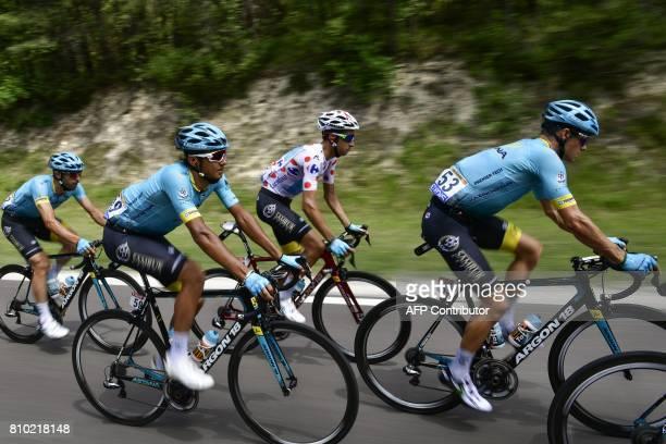 Riders of the Kazakhstan's Astana Pro cycling team Denmark's Jakob Fuglsang Italy's Fabio Aru wearing the best climber's polka dot jersey...