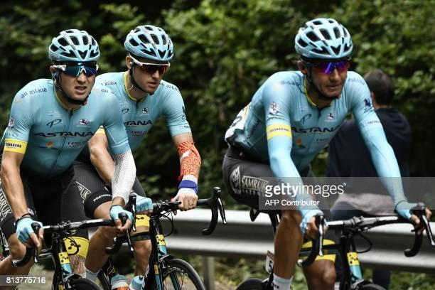Riders of the Kazakhstan's Astana Pro cycling team Kazakhstan's Andrej Zeits Denmark's Jakob Fuglsang and Kazakhstan's Alexey Lutsenko ride in the...