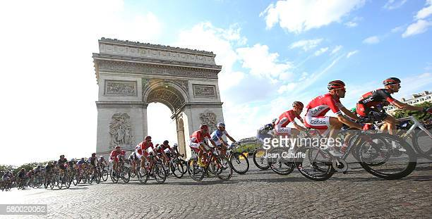 Riders of the Tour pass the Arc de Triomphe during stage 21 last stage of the Tour de France 2016 between Chantilly and the Champs Elysees Avenue on...