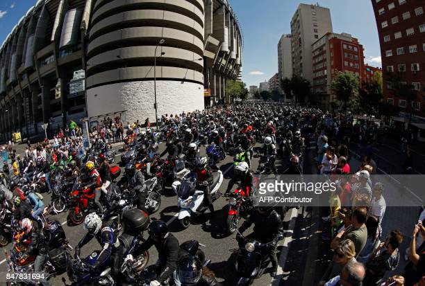 Riders on their bikes gather in Madrid to pay tribute to Grand Prix motorcycling legend Angel Nieto in front of the Santiago Bernabeu stadium on...