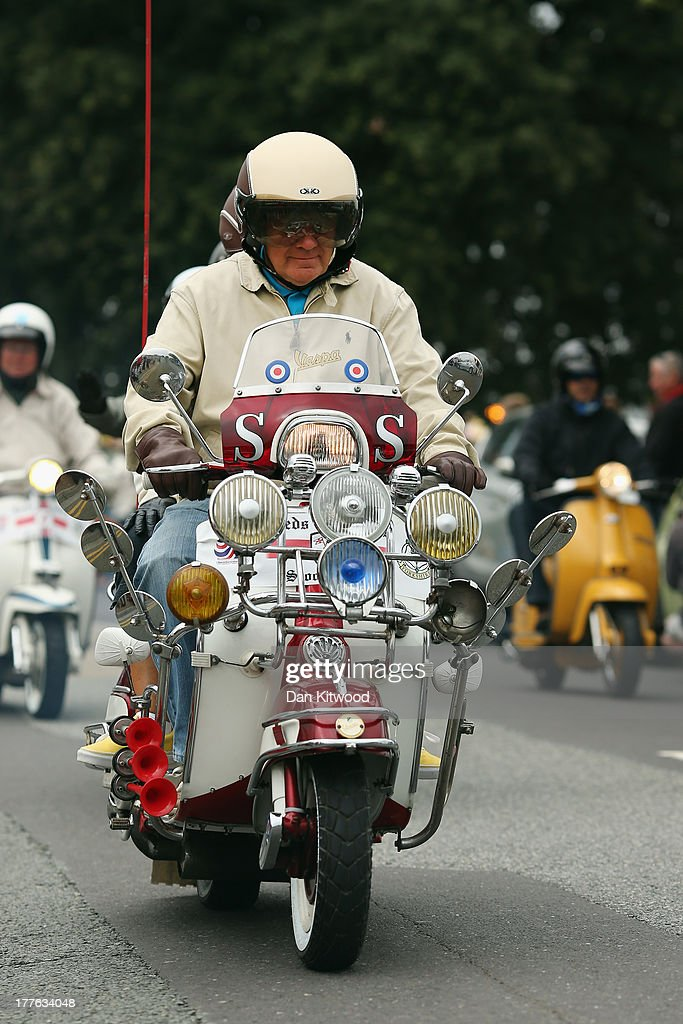 Riders participate in the 'Ride Out', which brings the Isle of Wight International Scooter Rally to a close on August 25, 2013 in Ryde, England. The annual event, which is organized by the British Scooter Rally Association and The VFM Scooter Collective, attracts around 6000 riders each year and has been running since 1980. The scooter in 1960s Britain was a fashion statement and the often heavily customized bikes, usually an Italian Vespa or Lambretta, became synonymous with the Mod scene. They provided an inexpensive mode of transport and escapism to an upwardly mobile youth at a time when public transportation stopped early. The Vespa was depicted on the cover of The Whos Quadrophenia album in 1973.