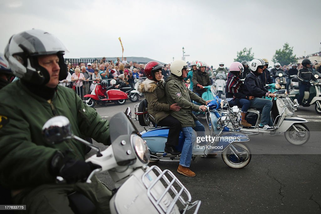 Riders participate in the 'Ride Out', which brings the scooter festival to a close on August 25, 2013 in Ryde, England. The annual event, which is organized by the British Scooter Rally Association and The VFM Scooter Collective, attracts around 6000 riders each year and has been running since 1980. The scooter in 1960s Britain was a fashion statement and the often heavily customized bikes, usually an Italian Vespa or Lambretta, became synonymous with the Mod scene. They provided an inexpensive mode of transport and escapism to an upwardly mobile youth at a time when public transportation stopped early. The Vespa was depicted on the cover of The Whos Quadrophenia album in 1973.