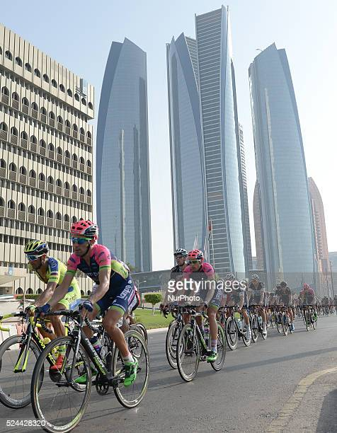 Riders pass in front of an immense fivetower skyscraper complex called Etihad Towers during The Capital second stage of the 2015 Abu Dhabi Tour the...