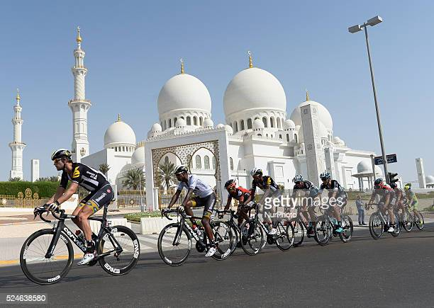 Riders pass in front of the Grande Mosque during The Capital second stage of the 2015 Abu Dhabi Tour the 129 km from Yas Marina Circuit to Yas Mall...