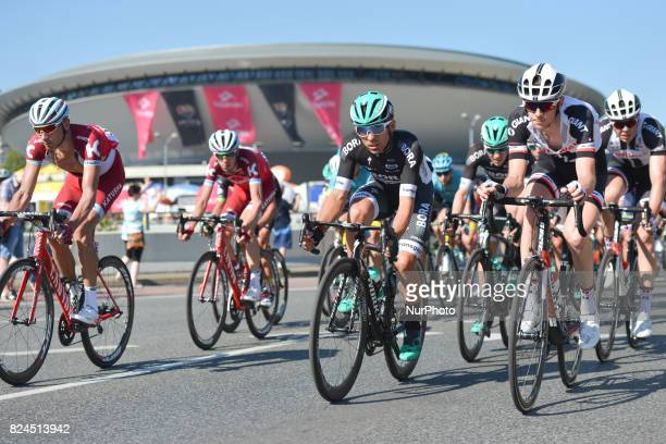Riders pass near Katowice's landmark building the SPodek Arena during the final laps of the second stage a 132km Tarnowskie Gpry Katowice during the...