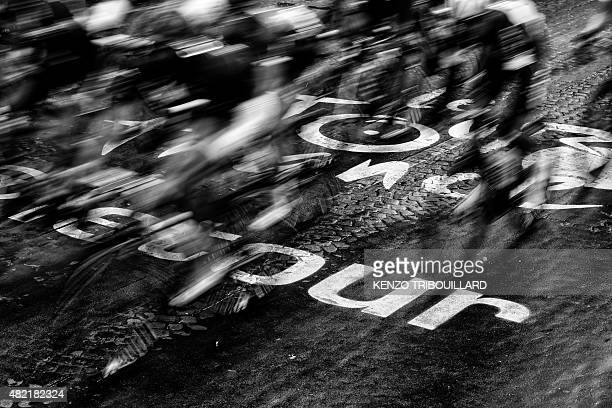 VERSION Riders pass over the logo of the Tour de France painted on the pavement during the twentyfirst and last stage of the 102nd edition of the...