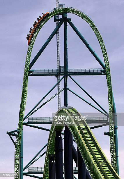 RECORD Riders pass the summit of the 'Kingda Ka' roller coaster 19 May at Six Flags amusement park in Jackson New Jersey The monster ride uses a...