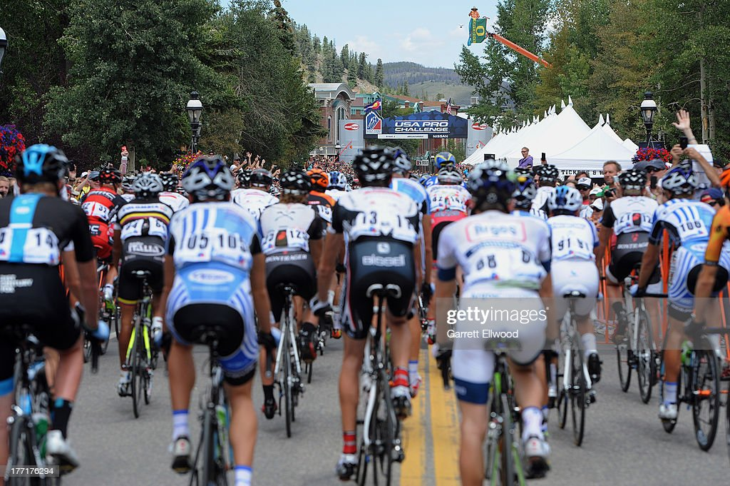 Riders pass through Main Street on the way out of town after the start of Stage Three of the USA Pro Cycling Challenge on August 21, 2013 in Breckenridge, Colorado.