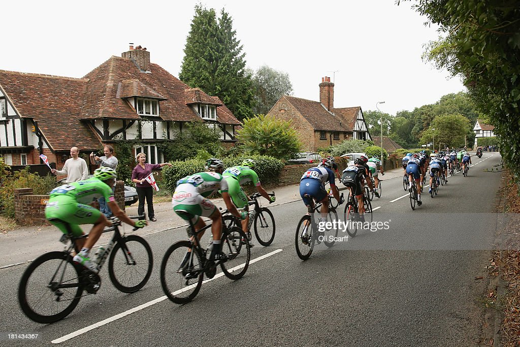 Riders pass through the small village of Compton during stage seven of the Tour of Britain from Epsom Racecourse to Guildford on September 21, 2013 in Compton, England. Today's 155km stage is the penultimate one before the race concludes in central London tomorrow. Sir Bradley Wiggins, riding for Team Sky Procycling, currently leads the race beginning today's stage with a 32 second advantage.