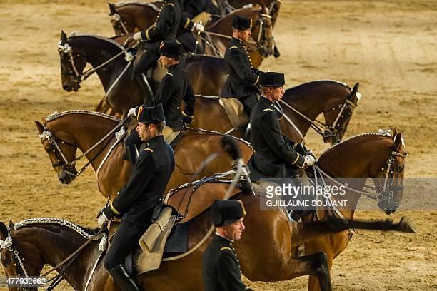 Riders perform at the French national equestrian school 'Le Cadre noir de Saumur' during the new show 'Danse avec le Cadre Noir' in Saumur on June 20...