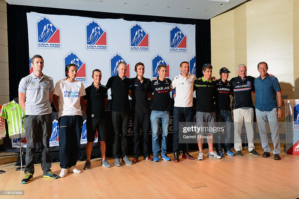 Riders pose for a group photo during the Kick-Off Press Conference prior to the start of the USA Pro Challenge at the Paepcke Auditorium on August 18, 2013 in Aspen, Colorado. Copyright 2013
