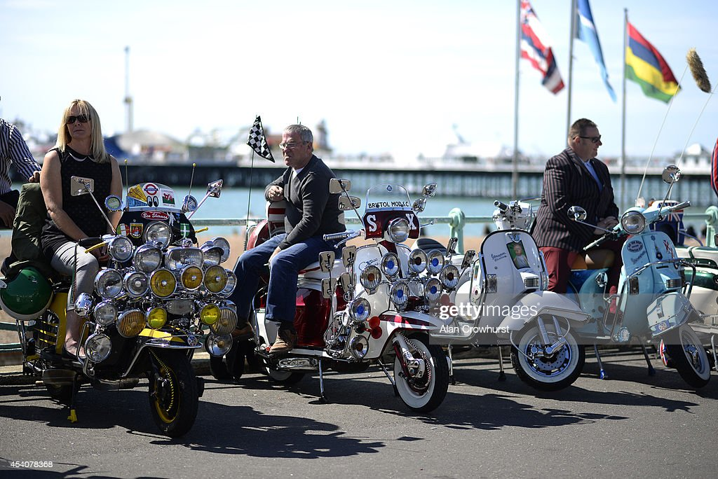 Riders relax on their scooters during the Brighton Mod weekender on August 24, 2014 in Brighton, England. This August Bank holiday will see many Mods and their scooters return to their spiritual home of Brighton for the Mod Weekender event.