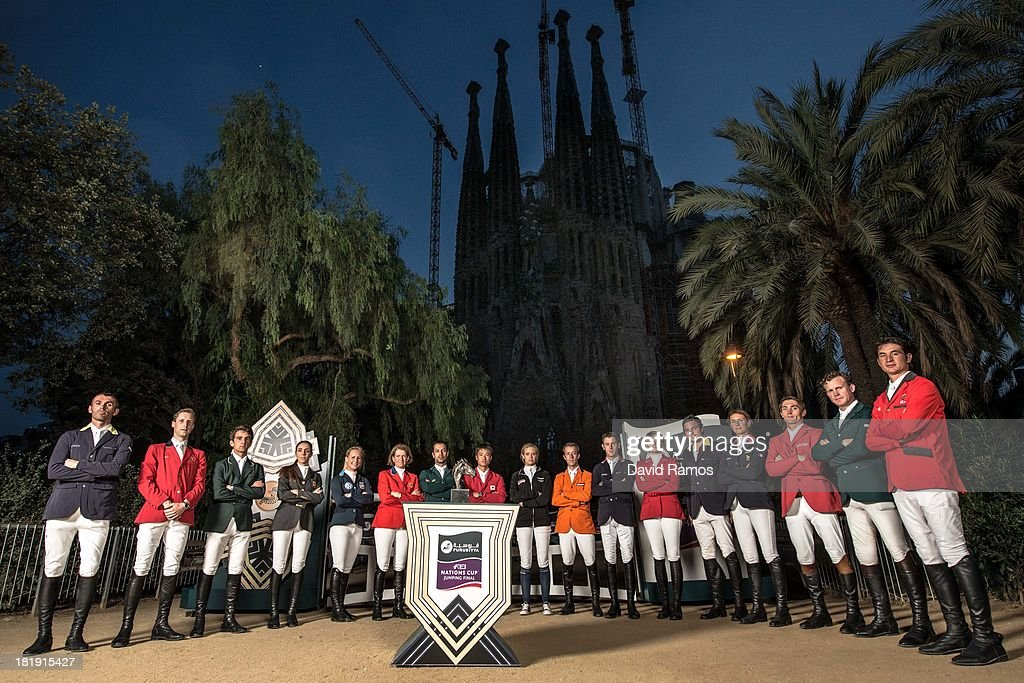 Riders representing the countries who will be competing at the first ever Furusiyya FEI Nations Cupâ Jumping Final (L-R) Oleg Krasyuk of Ukraine, Pieter Devos of Belgium, Marlon Zanotelli of Brazil, Paolo Amilibia Puig of Spain, Angelica Augustsson of Sweden, <a gi-track='captionPersonalityLinkClicked' href=/galleries/search?phrase=Beezie+Madden&family=editorial&specificpeople=628976 ng-click='$event.stopPropagation()'>Beezie Madden</a> of the USA, <a gi-track='captionPersonalityLinkClicked' href=/galleries/search?phrase=Kamal+Bahamdan&family=editorial&specificpeople=4069790 ng-click='$event.stopPropagation()'>Kamal Bahamdan</a> of Saudi Arabia, <a gi-track='captionPersonalityLinkClicked' href=/galleries/search?phrase=Taizo+Sugitani&family=editorial&specificpeople=605166 ng-click='$event.stopPropagation()'>Taizo Sugitani</a> of Japan, Julia Hargreaves of Australia, <a gi-track='captionPersonalityLinkClicked' href=/galleries/search?phrase=Maikel+van+der+Vleuten&family=editorial&specificpeople=9404628 ng-click='$event.stopPropagation()'>Maikel van der Vleuten</a> of the Netherlands, <a gi-track='captionPersonalityLinkClicked' href=/galleries/search?phrase=Scott+Brash&family=editorial&specificpeople=7104508 ng-click='$event.stopPropagation()'>Scott Brash</a> of Great Britain, Tiffany Foster of Canada, Daniel Bluman of Colombia, <a gi-track='captionPersonalityLinkClicked' href=/galleries/search?phrase=Penelope+Leprevost&family=editorial&specificpeople=5534219 ng-click='$event.stopPropagation()'>Penelope Leprevost</a> of France, Stefan Eder of Austria, Cameron Hanley of Ireland and <a gi-track='captionPersonalityLinkClicked' href=/galleries/search?phrase=Steve+Guerdat&family=editorial&specificpeople=2304249 ng-click='$event.stopPropagation()'>Steve Guerdat</a> of Switzerland pose for group portrait ahead of the event in front of La Sagrada Familia on September 25, 2013 in Barcelona, Spain.