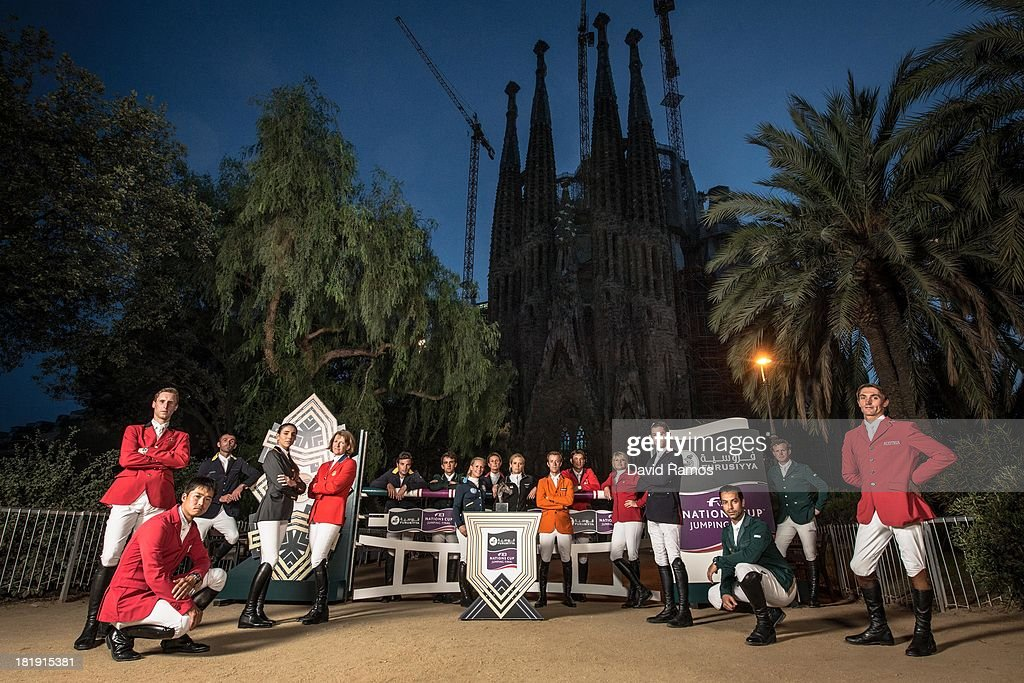 Riders representing the countries who will be competing for the first ever Furusiyya FEI Nations Cupa Jumping Final, (L-R) Pieter Devos of Belgium, <a gi-track='captionPersonalityLinkClicked' href=/galleries/search?phrase=Taizo+Sugitani&family=editorial&specificpeople=605166 ng-click='$event.stopPropagation()'>Taizo Sugitani</a> of Japan, Oleg Krasyuk of Ukraine, Paolo Amilibia Puig of Spain, <a gi-track='captionPersonalityLinkClicked' href=/galleries/search?phrase=Beezie+Madden&family=editorial&specificpeople=628976 ng-click='$event.stopPropagation()'>Beezie Madden</a> of the USA, Daniel Bluman of Colombia, Marlon Zanotelli of Brazil, Angelica Augustsson of Sweden, <a gi-track='captionPersonalityLinkClicked' href=/galleries/search?phrase=Penelope+Leprevost&family=editorial&specificpeople=5534219 ng-click='$event.stopPropagation()'>Penelope Leprevost</a> of France, Julia Hargreaves of Australia, <a gi-track='captionPersonalityLinkClicked' href=/galleries/search?phrase=Maikel+van+der+Vleuten&family=editorial&specificpeople=9404628 ng-click='$event.stopPropagation()'>Maikel van der Vleuten</a> of the Netherlands, <a gi-track='captionPersonalityLinkClicked' href=/galleries/search?phrase=Steve+Guerdat&family=editorial&specificpeople=2304249 ng-click='$event.stopPropagation()'>Steve Guerdat</a> of Switzerland, Tiffany Foster of Canada, <a gi-track='captionPersonalityLinkClicked' href=/galleries/search?phrase=Scott+Brash&family=editorial&specificpeople=7104508 ng-click='$event.stopPropagation()'>Scott Brash</a> of Great Britain, <a gi-track='captionPersonalityLinkClicked' href=/galleries/search?phrase=Kamal+Bahamdan&family=editorial&specificpeople=4069790 ng-click='$event.stopPropagation()'>Kamal Bahamdan</a> of Saudi Arabia, Cameron Hanley of Ireland, Stefan Eder of Austria pose for a group portrait ahead of the event in front of La Sagrada Familia on September 25, 2013 in Barcelona, Spain.