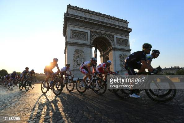 Riders round the Arc d'Triomphe during the twenty first and final stage of the 2013 Tour de France a processional 1335KM road stage ending in an...
