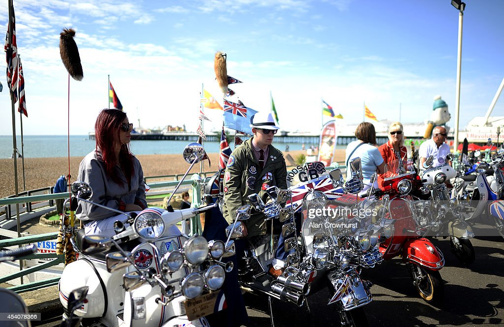 Riders sit on their scooters during the Brighton Mod weekender on August 24, 2014 in Brighton, England. This August Bank holiday will see many Mods and their scooters return to their spiritual home of Brighton for the Mod Weekender event.