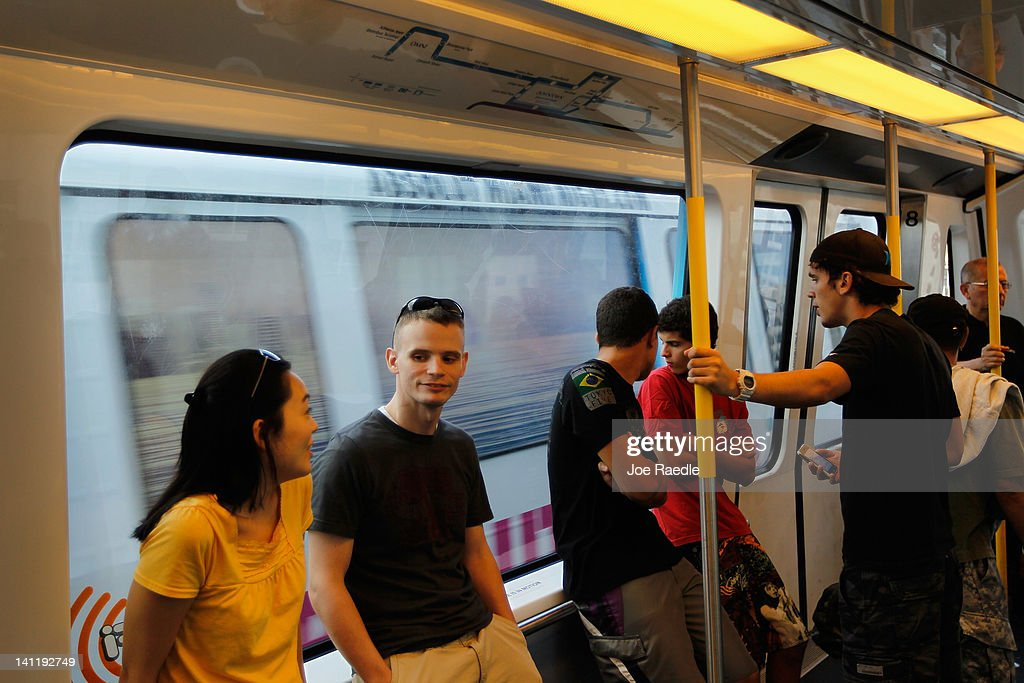 Riders stand in a car from the Miami-Dade county Metromover system on March 12, 2012 in Miami, Florida. With gas prices on the rise, mass transit systems around the country have seen a 2.31 percent rise in ridership during 2011 over the previous year according to the American Public Transportation Association.