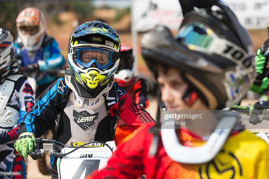 Riders take part in a race as part of the inauguration of the MX Wingate Motocross track near the Israeli city of Netanya on February 11, 2016. / AFP / JACK GUEZ