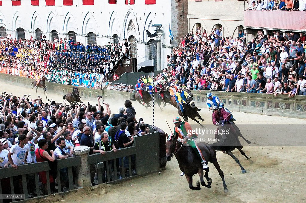 Riders take part in the famous Palio Di Siena horse race at Siena's Piazza del Campo Square on July 2 2015 in Siena Italy