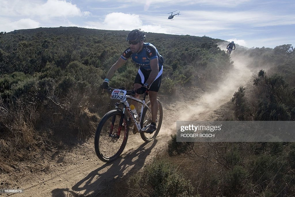 Riders take part on March 17, 2013 in the prolog stage of the 2013 Cape Epic Mountain Bike Race at the Meerendal Wine estate, about 30 kms from Cape Town. The eight-day race covers a distance of more than 800 kms, climbing more than 15,000 meters. AFP PHOTO / RODGER