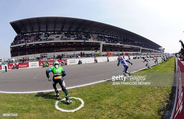 Riders take the start of the 33rd of the Le Mans 24hour endurance race on April 17 2010 in le Mans western France 165 riders competes during the race...