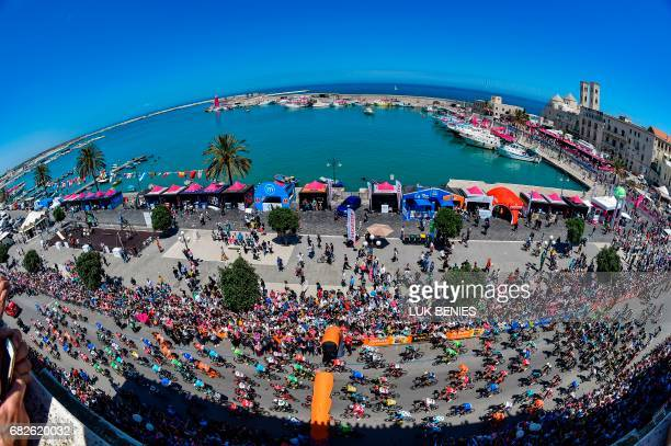 Riders take the start of the 8th stage of the 100th Giro d'Italia Tour of Italy cycling race from Molfetta to Peschici on May 13 2017 / AFP PHOTO /...
