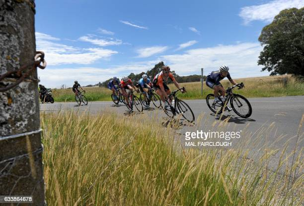 Riders turn a corner during stage three of the 2017 Herald Sun Tour cycling race in Melbourne on February 4 2017 / AFP / Mal Fairclough / IMAGE...