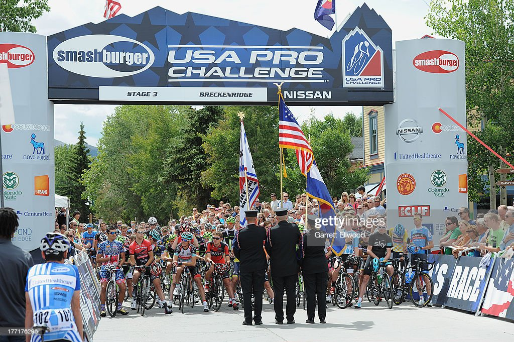 Riders wait for the National Anthem prior to the start of Stage Three of the USA Pro Cycling Challenge on August 21, 2013 in Breckenridge, Colorado.
