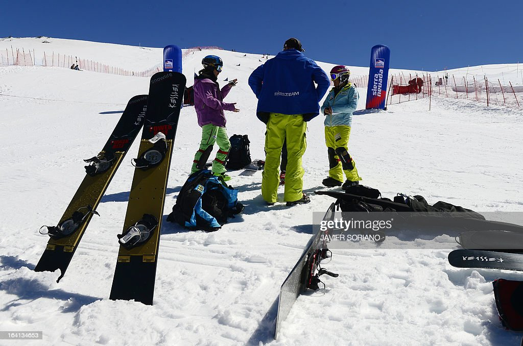 Riders wait on the finish line of the World Cup Parallel­ Giant Slalom race at the World Cup Super finals Snowboard and FreeStyle at Sierra Nevada ski resort near Granada March 20, 2013. The World Cup Parallel­ Giant Slalom race was cancelled due to bad snow conditions.