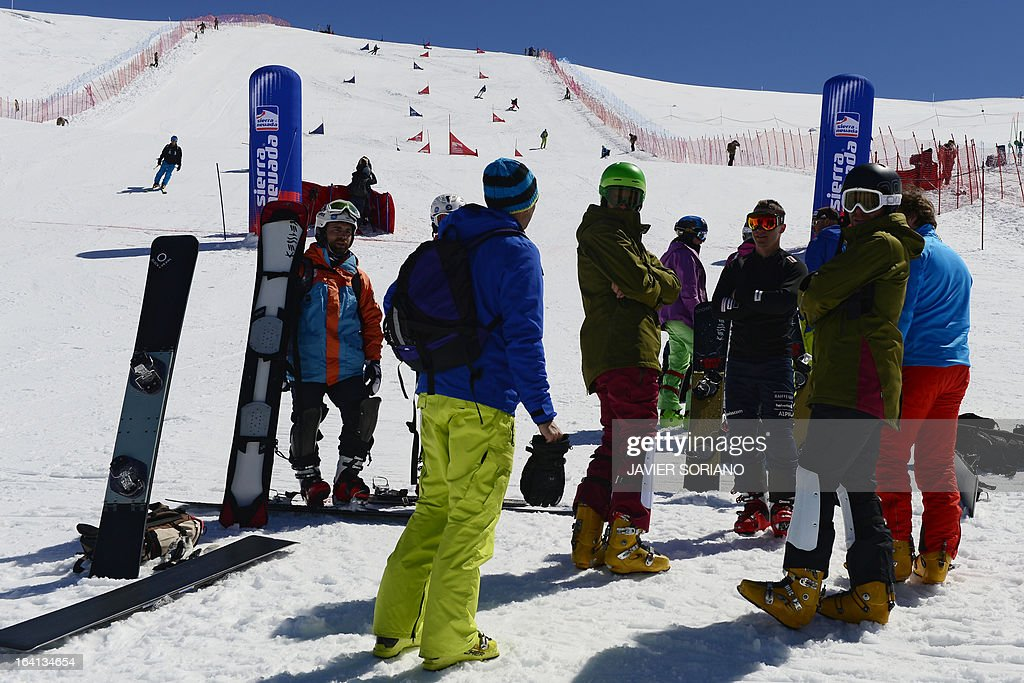 Riders wait on the finish line of theWorld Cup Parallel Giant Slalom race at the World Cup Super finals Snowboard and FreeStyle at Sierra Nevada ski resort near Granada March 20, 2013. The World Cup Parallel Giant Slalom race was cancelled due to bad snow conditions.