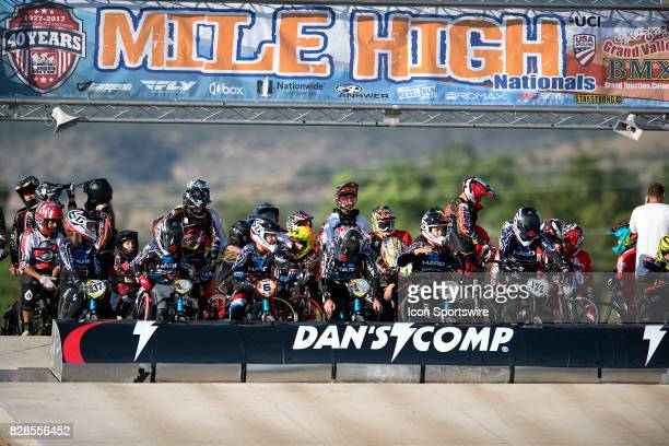 Riders wait on the starting hill before the opening parade lap at the USA BMX Mile High Nationals on August 6 at Grand Valley BMX in Grand Junction CO