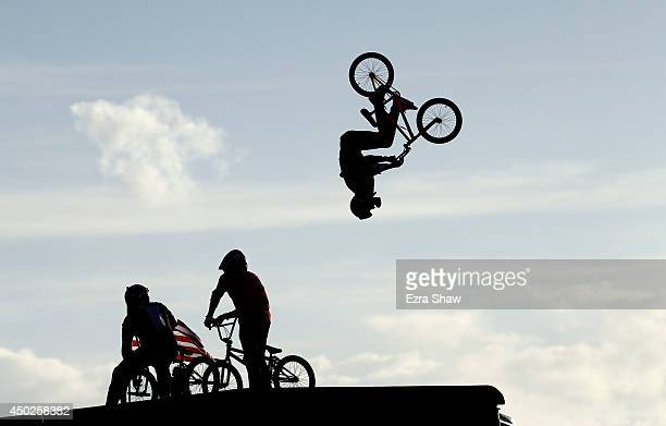 Riders watch as Steve McCann of Australia warms up for the BMX Big Air Finals during the X Games Austin at Circuit of The Americas on June 7 2014 in...