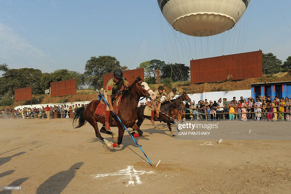 Ridersfrom the elite Gujarat Mounted Police Force prepare to spear targets during an equestrian display in Ahmedabad on December 30, 2012. The event was organised as part of the ongoing Kankariya Carnival. AFP PHOTO / Sam PANTHAKY