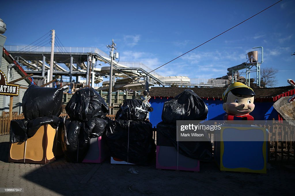 Rides sit covered up at the Fantasy Island Amusement park that was flooded by Superstorm Sandy, on November 24, 2012 in Long Beach Island, New Jersey. New Jersey Gov. Christie estimated that Superstorm Sandy will cost New Jersey $29.4 billion in damage and economic losses.