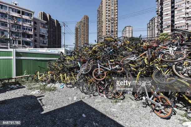 Ridesharing bicycles sit in a pile in Shanghai China on Thursday Sept 12 2017 Across Chinese cities sidewalks are filling up with bicyclescosting a...