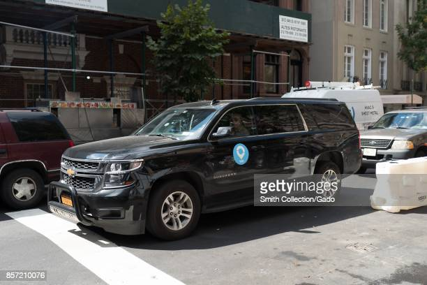 A ridesharing car from the company Via passes through an intersection on Madison Avenue on the Upper East Side of Manhattan New York City New York...
